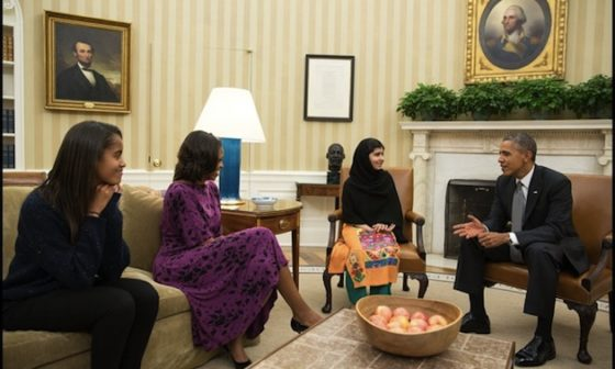 While BBC, The Washington Post and other international and U.S. media used this photo, the Voice of America (VOA), U.S. taxpayer-funded media outlet for international audiences, did not. President Barack Obama, First Lady Michelle Obama, and their daughter Malia meet with Malala Yousafzai, the young Pakistani schoolgirl who was shot in the head by the Taliban a year ago, in the Oval Office, Oct. 11, 2013. (Official White House Photo by Pete Souza)