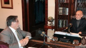 Afghan President Hamid Karzai (right) sits down with RFE/RL's Akbar Ayazi in Kabul on November 26.